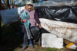 An activist poses next to a verse by Robert Burns at Poors Piece Protection Camp on 26th April 2021 in Steeple Claydon, United Kingdom. Poors Piece Protection Camp is one of several protest camps set up by environmental activists in opposition to the HS2 high-speed rail infrastructure project along its Phase 1 route between London and Birmingham.
