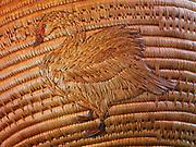 Figure of White-fronted Goose on large antique Yupik Eskimo grass basket from Western Alaska.