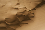 Closeup of abstract desert sand pattern at the sand dunes at Lagoon Khenifiss (Lac Naila), Morocco.