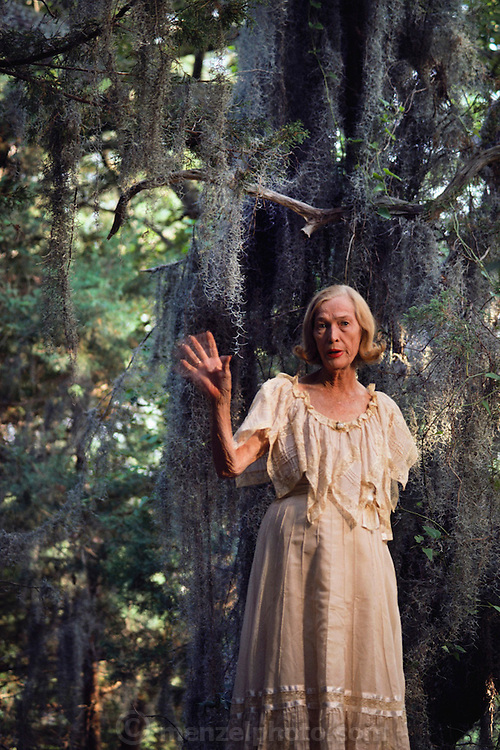 An elderly woman visits the site where she grew up in Nags Head Woods, North Carolina. MODEL RELEASED.