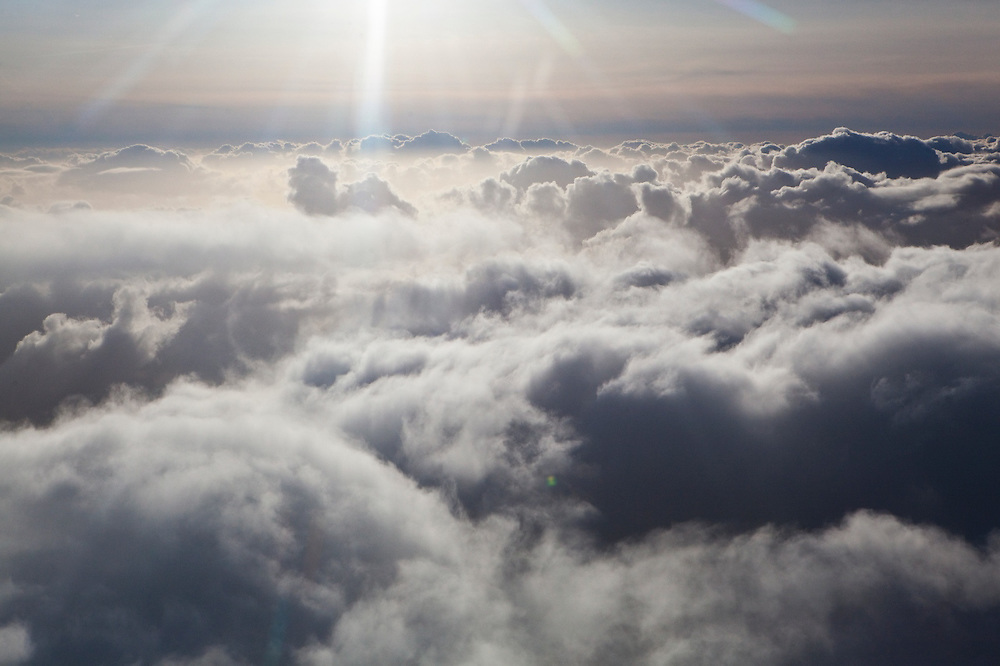 Dramatic storm clouds seen from above in an airplane.