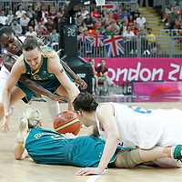 30 July 2012: Samantha Richards and Jennifer Screen of Australia vie for the loose ball with Clemence Beikes and Emilie Gomis of France during the 74-70 Team France overtime victory over Team Australia, during the women's basketball preliminary, at the Basketball Arena, in London, Great Britain.