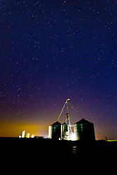 A starry night shows off a grain drying and storage facility in Central Illinois