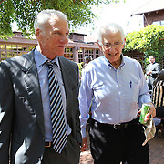 Government whistleblower Daniel Ellsberg (right) walks Ed Wasserman, Dean of the UC Berkeley Graduate School of Journalism during the first week orientation for incoming students at North Gate Hall in Berkeley, California, on Wednesday, August 27, 2014. Ellsberg, who is most famous for his role in the Pentagon Papers ordeal, interacted with students about such topics as freedom of the press, whistleblowers Eric Snowden and Chelsea Manning, and the responsibilities and ethical morals of reporters and other members of the media. (AP Photo/Alex Menendez)