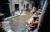 Backstreets of Guangzhou - Old Canton, locals prepare live seafood for sale.