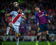 Leo Messi of Barcelona (right)  heads up the ball  during the Spanish league football match of 'La Liga'  FC BARCELONA against RAYO VALLECANO at Camp Nou Stadium of Barcelona on March 9,2019