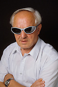 Old man looking tough in sunglasses