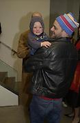 Gavin Turk and his baby. Sam Taylor Wood opening. White Cube. London. 22 Nov 2001. © Copyright Photograph by Dafydd Jones 66 Stockwell Park Rd. London SW9 0DA Tel 020 7733 0108 www.dafjones.com