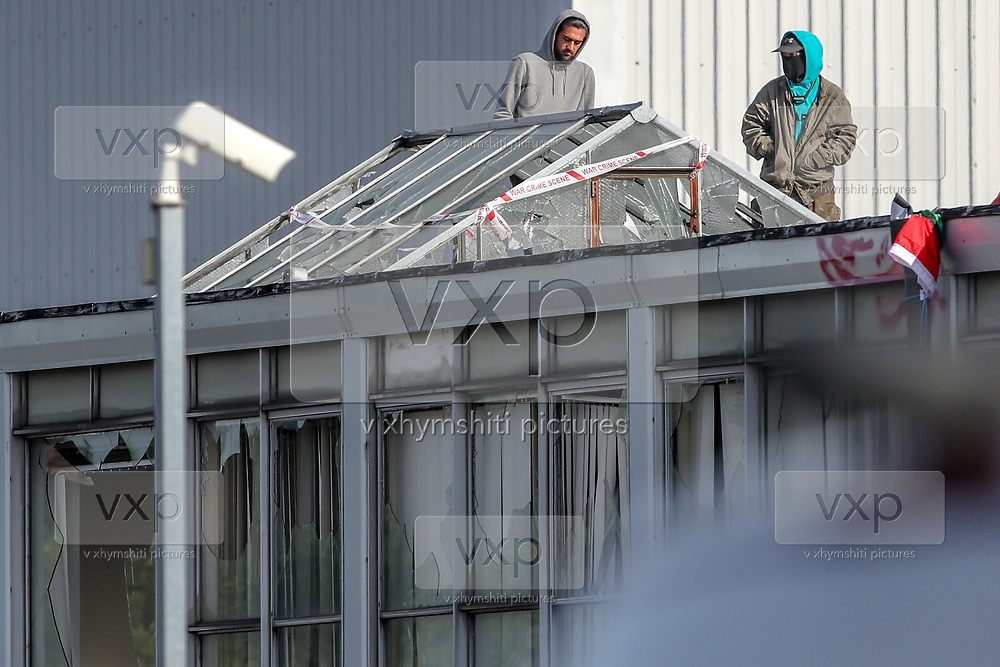 Birmingham, United Kingdom, June 15, 2021: Two activists of the 'Palestine Action' activists group are seen walking on the rooftop of an American industrial factory known as Arconic in Birmingham for the 2nd day on Tuesday, June 15, 2021. This is a protest against the company who they say 'provided cladding for Grenfell Tower' and 'materials for Israel's fighter jets.' (Photo by Vudi Xhymshiti)