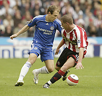 Photo: Aidan Ellis.<br /> Sheffield United v Chelsea. The Barclays Premiership. 28/10/2006.<br /> Chelsea's Arjen Robben beats Sheffield's Chris Armstrong