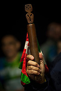 """The baton on the 20th Korrika. Cintruenigo (Basque Country). April 1, 2017. The """"Korrika"""" is a relay course, with a wooden baton that passes from hand to hand without interruption, organised every two years in a bid to promote the basque language. The Korrika runs over 11 days and 10 nights, crossing many Basque villages and cities. This year was the 20th edition and run more than 2500 Kilometres. Some people consider it an honour to carry the baton with the symbol of the Basques, """"buying"""" kilometres to support Basque language teaching. (Gari Garaialde / Bostok Photo)"""