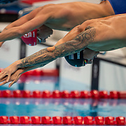TOKYO, JAPAN - JULY 31:   Caeleb Dressel of the United States winning gold in a world record time in the 100m Butterfly Final for men during the Swimming Finals at the Tokyo Aquatic Centre at the Tokyo 2020 Summer Olympic Games on July 31, 2021 in Tokyo, Japan. (Photo by Tim Clayton/Corbis via Getty Images)
