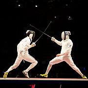 TOKYO, JAPAN - JULY 30:   Masaru Yamada of Japan (left) in action against Pavel Sukhov of ROC during the Japan V ROC gold medal match won by Japan 45-36  during the fencing epee team event for men at the Makuhari Messe at the Tokyo 2020 Summer Olympic Games on July 30, 2021 in Tokyo, Japan. (Photo by Tim Clayton/Corbis via Getty Images)
