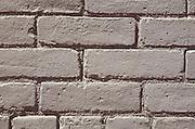 Close up of a gray painted brick wall.