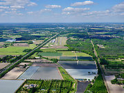 Nederland, Brabant,  gemeente Halderberge, 14-05-2020; A58 tussen het dorp Hoeven en St. Willebrord. Zicht op Vliegveld Seppe (Breda International Airport).<br /> A58 between the village of Hoeven and St. Willebrord. View of Seppe Airport (Breda International Airport).<br /> <br /> luchtfoto (toeslag op standard tarieven);<br /> aerial photo (additional fee required);<br /> copyright foto/photo Siebe Swart