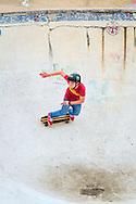 Teenager on Skateboard at The Rom Skateboard Park, Hornchurch, Essex, Britain.