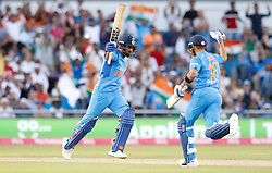 India's Lokesh Rahul (left) celebrates making his century against England, during the 1st Vitality IT20 Series match at Emirates Old Trafford, Manchester.