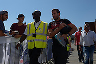 Yohan Cabaye of Crystal Palace being escorted into  Selhurst Park before k/o. Barclays Premier league match, Crystal Palace v Aston Villa at Selhurst Park in London on Saturday 22nd August 2015.<br /> pic by John Patrick Fletcher, Andrew Orchard sports photography.