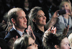 Prince William and his fiancee Kate Middleton watch a student dance show during a visit to Darwen Aldridge Community Academy in Darwen, Lancashire.