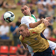 Grant Smith (top) and Jobe Wheelhouse in action during the Newcastle Jets V North Queensland Fury  A-League match at Energy Australia Stadium, Newcastle, Australia, 20 December 2009. Photo Tim Clayton