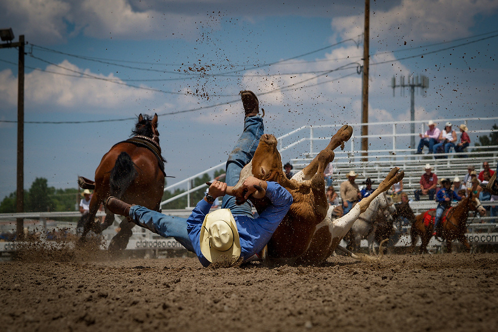 ZACHARY PARRINGTON competes in the Steer Wrestling event at the Cheyenne Frontier Days Rodeo.