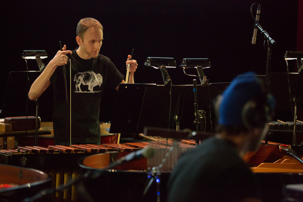 Brooklyn, NY - 20 January 2015. The dress rehearsal of Sufjan Stevens' Round-Up, with slow motion film of the Pendleton, Oregon Round-Up by Aaron and Alex Craig, music performd by Sufjan Stevens and Yarn/Wire. Ian Antonio is seen bowing the xylophone.
