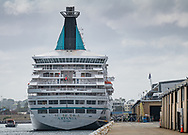 Travelers are evacuated from the Artania in Fremantle, Western Australia.