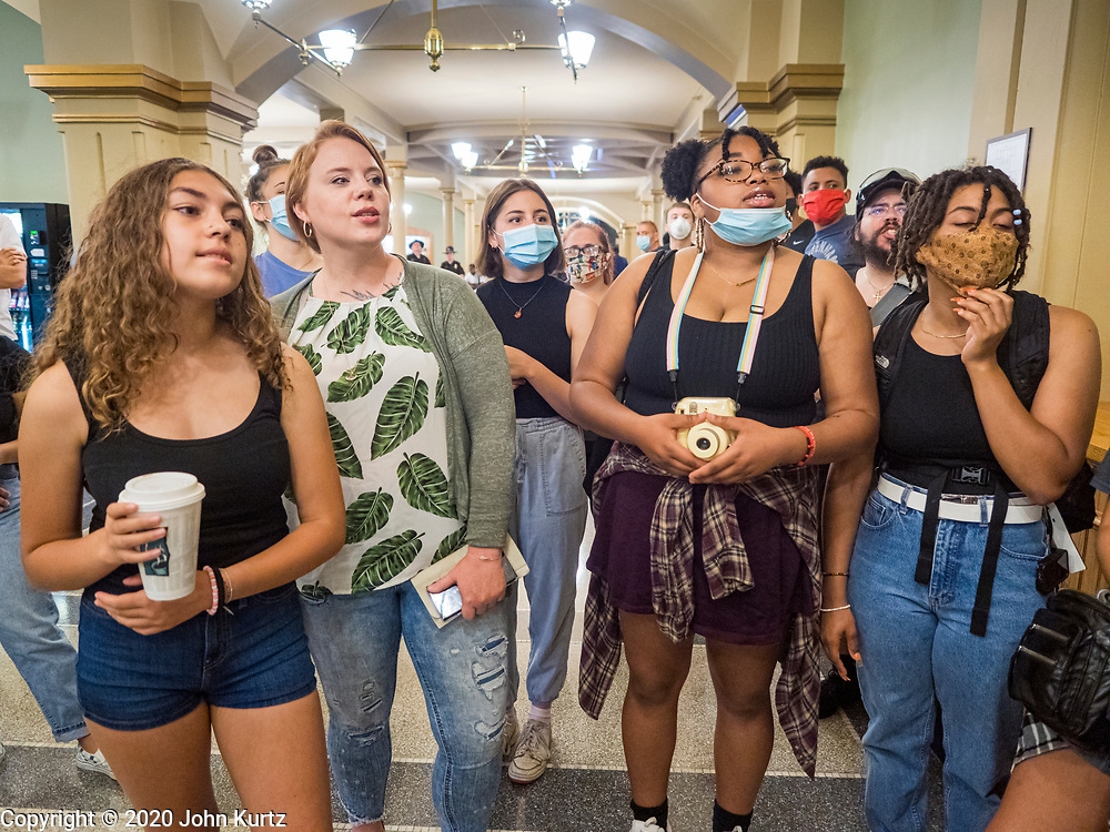 12 JUNE 2020 - DES MOINES, IOWA: Supporters of Black Lives Matter conduct a protest in front of the Governor's office in the Iowa capitol. About 75 activists from Black Lives Matter came to the Iowa State Capitol in Des Moines Friday to talk to Iowa Governor Kim Reynolds. They've been trying to meet with Gov. Reynolds all week. She made time for them Friday and met with 5 representatives of the organization without any media in the room. They wanted to talk to her about police violence against African-Americans and racial disparities in Iowa's justice system. While the 5 met with the Governor, the remaining activists picketed the hall in front of her office and chanted.     PHOTO BY JACK KURTZ
