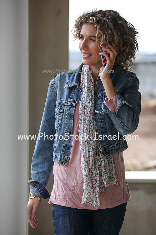 Stylish woman in a construction site