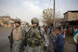 """Translator Mushtag """"Mitch"""" Alleathe and Maj. Jonathan Fox, of the 1st Infantry, 17th Regiment, are seen on patrol in western Mosul, Iraq, Dec. 16, 2005. This is part of an effort to provide security in preparation for Iraq's first post-Saddam parliamentary elections. The western sector is home to Mosul's primarily Sunni population, which has been resistant to the American presence in Iraq."""