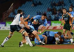 28/04/2013.  Vodacom Bulls captain Pierre Spies tries to make his way past  Waratahs players during their super rugby clash at Loftus Versfeld on Saturday. <br /> Picture: Masi Losi