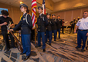 Members of the Lamar JROTC present the Colors during the Scholars Banquet at the Westin Galleria, April 11, 2017.