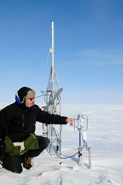 Alaska, Barrow. Scientist at Barrow Environmental Observatory (BEO) measuring CO2 and Methane gas release by the tundra and it's effects on climate change. Spring April 2008