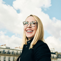 Alyssa Fenoglio, Texas A&M University alumni, posing at home on a blue backdrop. Paris, France. February 2021.