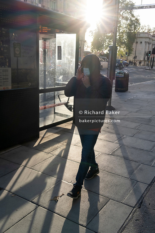As the UK reacts to Prime Minister Boris Johnson's announcement of Lockdown 2 during the second wave of the Coronavirus pandemic, a man walks through a patch of sunlight on Oxford Street, on 2nd November 2020, in London, England. From midnight on Thursday, all non-essential shops, bars, restaurants and other small businesses will have to closed, according to government Covid restrictions - and for a minimum of 4 weeks in the run-up to Christmas.