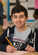 Enrique Garza poses for a photograph at Fleming Middle School, February 13, 2015.