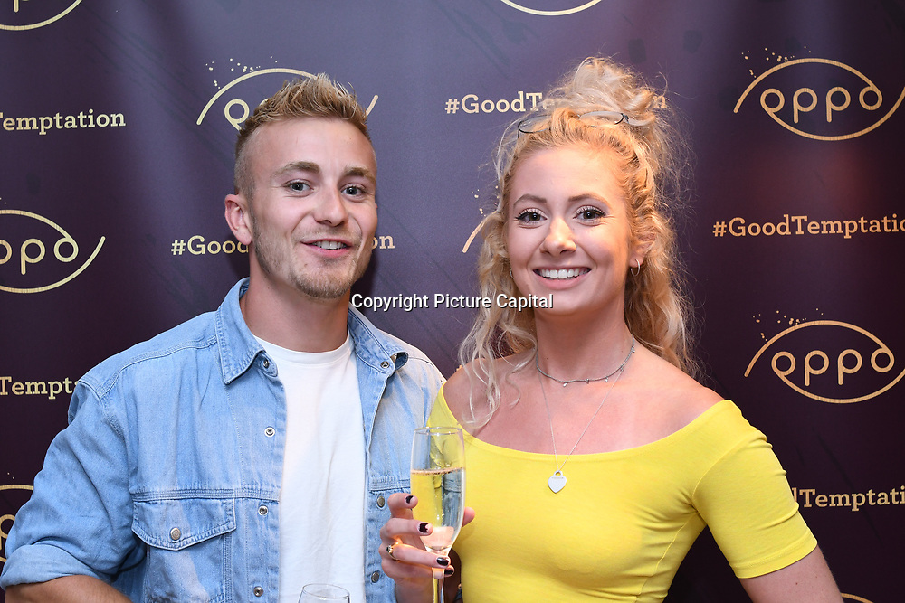 Marcus Verrell , Zoe Rolph blogger @zoefit_uk  attend the Oppo party to launch its new Madagascan Vanilla, Sicilian Lemon and Raspberry Cheesecakes, served with Skinny Prosecco at Farm Girls Café, 1 Carnaby Street, Soho, London, UK on July 18 2018.