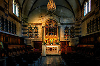 """""""Relic room of the Cathedral of Sant'Andrea - Amalfi""""...<br /> <br /> I caught the rain soaked ferry down the coast to the seaside town of Amalfi. The Duomo di Amalfi is usually packed with tourists bused and ferried from 100's of miles away, but with the dreary weather many stayed away. A church has resided on this site in Amalfi since 596 AD and the one built in the 9th century still stands today. The present cathedral was built adjacent to the old one in the early 13th century to provide a suitable resting place for St. Andrew the Apostle. The two were originally joined together to form a single, six-nave Romanesque cathedral. Newer walls have been taken down to expose parts of the ancient original church, and one can ponder history by this glimpse back in time. Andrew, Saint Peter's brother and one of Christ's closest disciples was also the disciple of John the Baptist. Saint Andrew was called with Peter: """"As [Jesus] was walking by the Sea of Galilee, he saw two brothers, Simon who is now called Peter, and his brother Andrew, casting a net into the sea; they were fishermen. He said to them, 'Come after me, and I will make you fishers of men.' At once they left their nets and followed him"""" (Matthew 4:18-20). Stairs near the east end of the Duomo descend into the Crypt of St. Andrew, where his relics are kept in the central altar. The crypt is decorated with magnificent Baroque murals from 1660. As I knelt and prayed at the glorious crypt befitting this great disciple who was martyred on an X shaped crucifix, my mind wondered of the true nature of this chosen man who became a Saint. I stirred around to the back of the altar and found myself facing his eternal light and relics. I knelt again in prayer feeling the great essence and presence of this selfless apostle. As in many other locations and churches in Italy, where Saints seem to be from every town, I was overcome with deep emotion and an abundance of heartfelt spiritual joy!"""