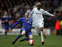 Photo: Paul Thomas.<br /> Bolton Wanderers v Everton. The Barclays Premiership. 09/04/2007.<br /> <br /> El-Hadji Diouf (R) of Bolton is tackled by Tony Hibbert.