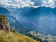 """From Männlichen, look down to Wengen in Lauterbrunnen Valley, Berner Oberland, Switzerland, the Alps, Europe. Lauterbrunnen Breithorn rises to 3780 meters or 12,402 feet elevation at the head of the valley. The world's longest continuous rack and pinion railway (Wengernalpbahn) goes from Grindelwald up to Kleine Scheidegg and down to Wengen and Lauterbrunnen. A gondola (gondelbahn) connects Grindelwald with Männlichen, where a cable car goes down to Wengen (Luftseilbahn Wengen-Männlichen). The Bernese Highlands are the upper part of Bern Canton. UNESCO lists """"Swiss Alps Jungfrau-Aletsch"""" as a World Heritage Area (2001, 2007). Published in a two-page spread for COX Travel / Destination Switzerland in Travel+Leisure magazine, May 2014, Time Inc Affluent Media Group."""