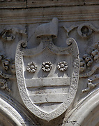 (Detail) architectural feature on the facade of the Doge's Palace in Venice, Italy. The palace was the residence of the Doge of Venice, the supreme authority of the Republic of Venice. Its two most visible façades look towards the Venetian Lagoon and St. Mark's Square, or rather the Piazzetta. The use of arcading in the lower stories produces an interesting 'gravity-defying' effect. There is also effective use of colour contrasts. largely constructed from 1309 to 1424, designed perhaps by Filippo Calendario. It replaced earlier fortified buildings of which relatively little is known. Giovanni and Bartolomeo Bon created the Porta della Carta in 1442, a monumental late-gothic gate on the Piazzetta side of the palace. This gate leads to a central courtyard. The palace was badly damaged by a fire on December 20, 157
