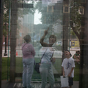 BOSTON, MASS- July 13, 2005:  Visitors view the numbers etched into glass at a memorial to WWII Holocaust victims in Boston, Massachusetts on July 13, 2005. (Photo by Todd Bigelow/Aurora)