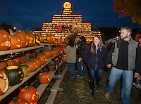 The Tower along with pumpkins illuminating the streets of downtown Laconia during Saturday's Pumpkin Fest.   (Karen Bobotas/for the Laconia Daily Sun)