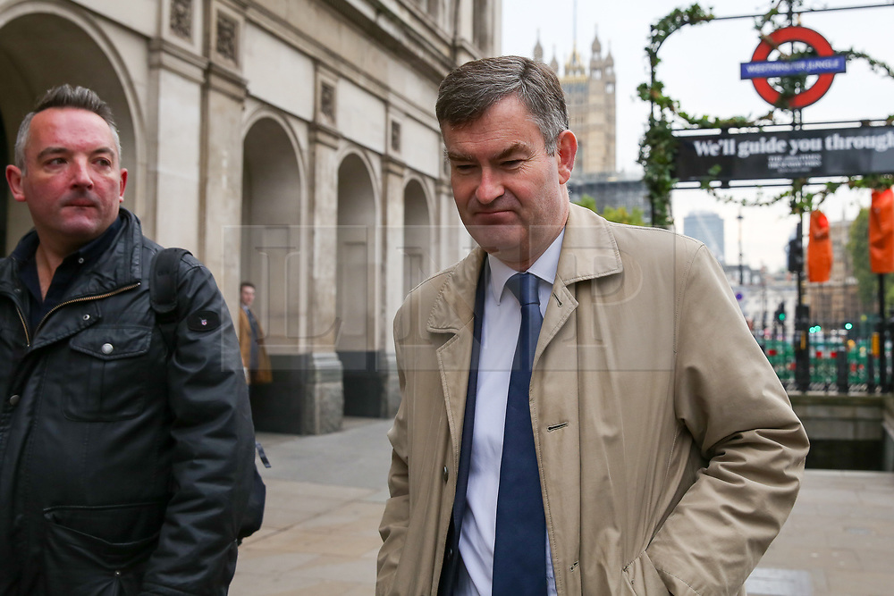 """© Licensed to London News Pictures. 23/10/2019. London, UK. Former Justice Secretary David GAUKE is seen in Westminster. On Tuesday 22 October 2019, MPs rejected Prime Minister BORIS JOHNSON'S fast-track timetable for ratifying the Brexit deal and the government """"paused"""" the parliamentary process — almost certainly ending any prospect of Brexit on 31 October.  Photo credit: Dinendra Haria/LNP"""
