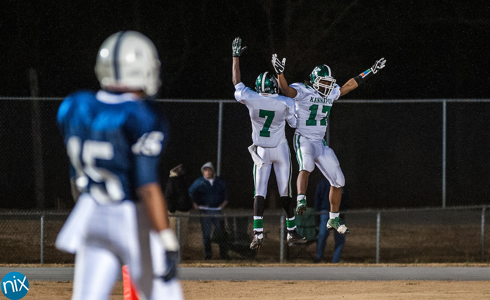 Kannapolis'd Kalif Phillips (17) and Johny Delahussaey (7) celebrate a score against Hickory Ridge in the second round of the NCHSAA playoffs Friday night in Harrisburg. Kannapolis out scored the Ragin' Bulls 69-55 to advance in the playoffs.