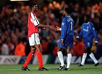 Nigerian team mates Kanu (Arsenal) and Celestine Babayaro (Chelsea) shake hands after the match. Chelsea 2:2 Arsenal, F.A. Carling Premiership, 6/9/2000. Credit: Colorsport / Stuart MacFarlane.
