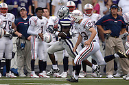 Kansas State's Justin McKinney (22) sprints past Florida Atlantic's Felix Callazo (23), as McKinney takes the opening Kick-Off for a 88-yard touchdown return at Bill Snyder Family Stadium in Manhattan, Kansas, September 9, 2006.  The Wildcats beat Florida Atlantic 45-0.