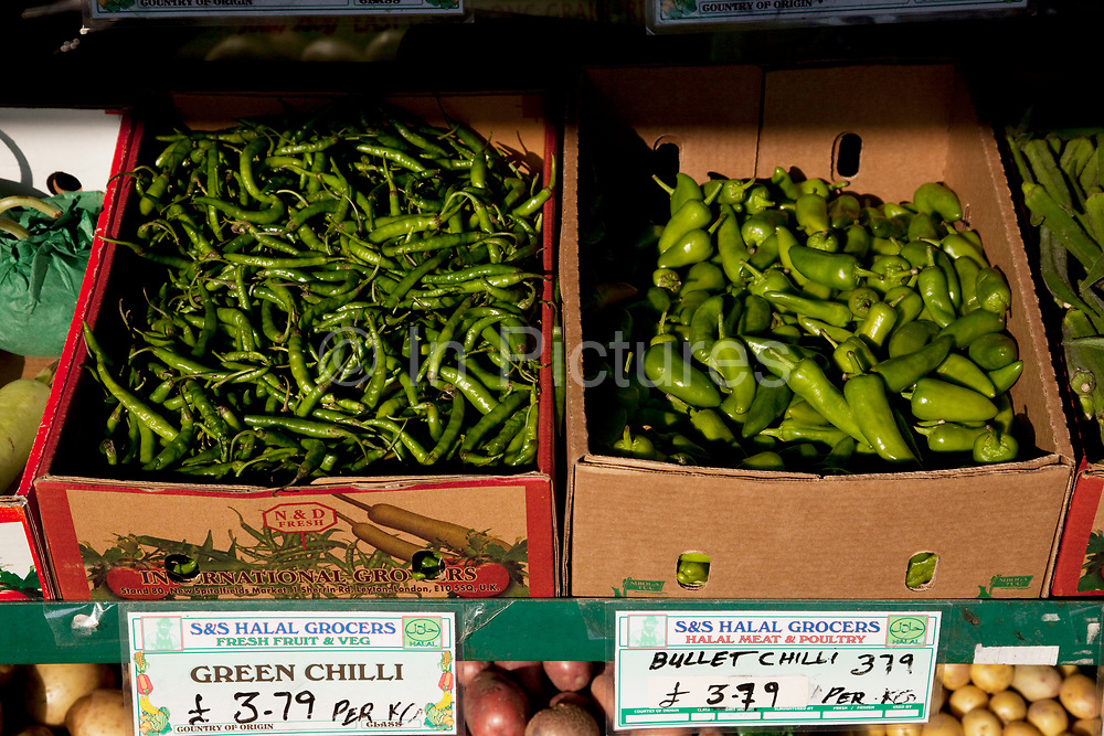 Chillies for sale in Southall in West London, also known as 'Little India' by some, is an area almost completely populated by people from South Asia. Figures show that the area is approximately 50 percent Indian in origin although walking the streets it would appear far higher as the local people go about their shopping in the many shops specialising in goods specific to this culture. The mix of religions is mainly Sikh, Hindu and Muslim.<br /> <br /> Southall is primarily a South Asian residential district. 1950 was when the first group of South Asians arrived in Southall, reputedly recruited to work in a local factory owned by a former British Indian Army officer. This South Asian population grew due to the closeness of expanding employment opportunities. The most significant cultural group to settle in Southall are Indian Punjabis.