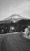 9111-277. Mt. Hood & car from Laurel Hill.  Mt. Hood Loop highway, Highway 26, after re-grading and before paving. Road was built in 1925.