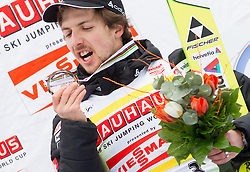 AMMANN Simon( SUI), overall Third placed at  Skiflying classification. celebrates at trophy ceremony after the Flying Hill Individual competition at 4th day of FIS Ski Jumping World Cup Finals Planica 2012, on March 18, 2012, Planica, Slovenia. (Photo by Vid Ponikvar / Sportida.com)